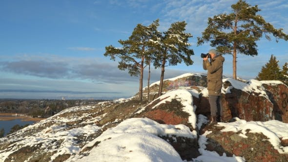Thumbnail for Scandinavian Landscape, Tourist in the Winter Forest