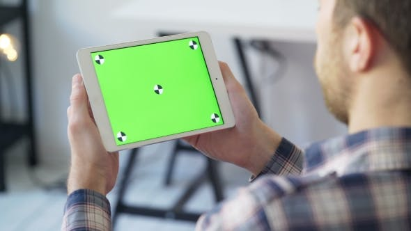 Thumbnail for Businessman Holds in Hands and Uses Device With Touch Green Screen
