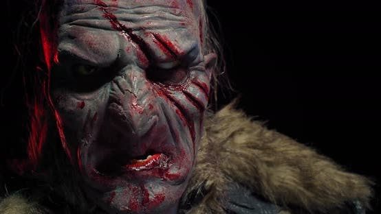 Heavy Breathing and Panting Orc with Blood on His Face, Black Background,
