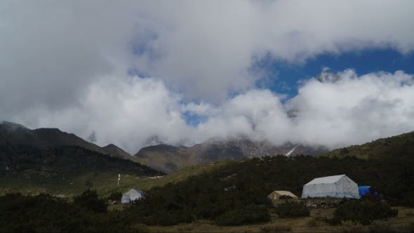 Thumbnail for Fast Moving Clouds and Tents Under the Mountain