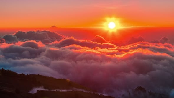 Cover Image for Sunset on the Mountain and Below the Clouds at Rinjani Volcano, Lombok, Indonesia