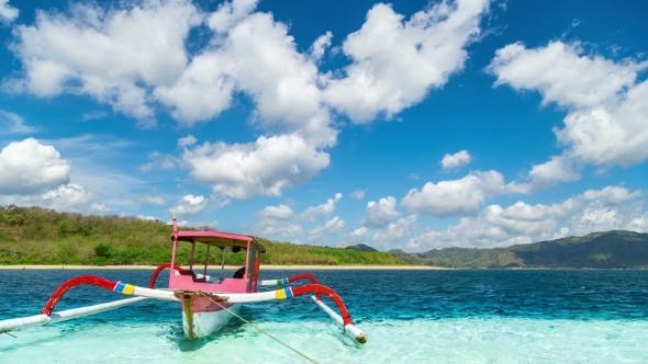 Cover Image for Traditional Boat in Turquoise Water on the Island of Gili Nanggu, Lombok, Indonesia