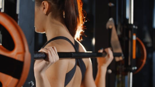 Cover Image for Woman Training with Barbell Sport Simulator in Gym Workout