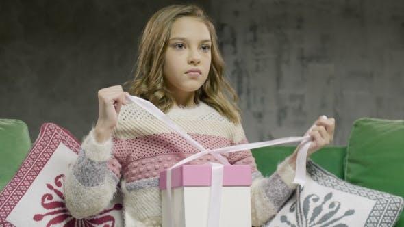 Thumbnail for Unhappy Sad Teenage Girl Sitting Open Gift Box
