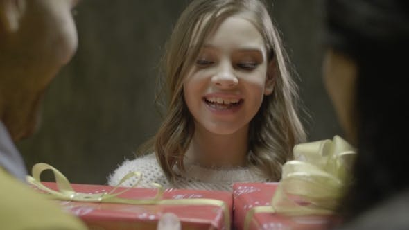 Thumbnail for Smiling Girl Take Family Xmas Box From Parents