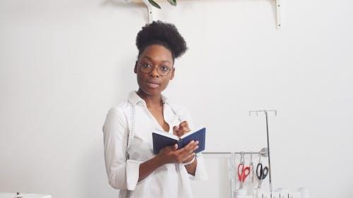 Happy Fashion Designer in Small Business Startup Company