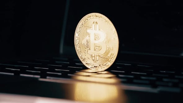 Thumbnail for Bitcoin Coin Falling Down on the Laptop Keyboard