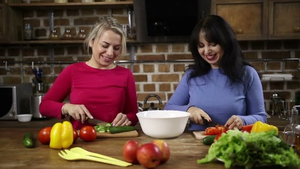 Thumbnail for Cheerful Women Preparing Healthy Salad in Kitchen