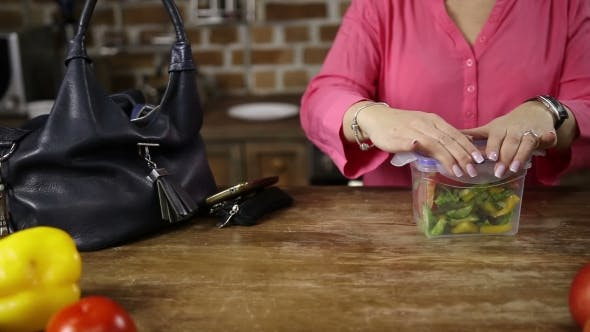 Thumbnail for Female Hands Packing Lunch Into Bag in Kitchen