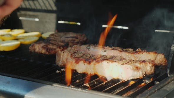 Thumbnail for Turn Over the Juicy Pieces of Beef. Authentic American Barbecue.