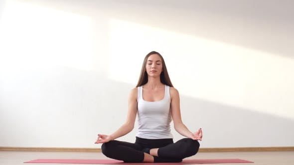 Young Adult Female Doing Yoga at Home