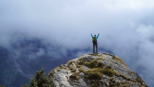 Thumbnail for Girl with Backpack Reaching Up Top of Mountain and Raised Hands