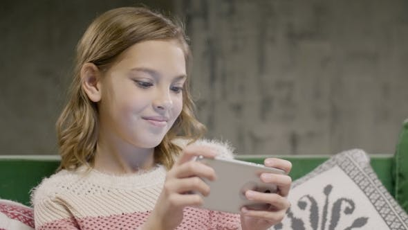 Thumbnail for Young Girl Emotional Play Game on the Smart Phone