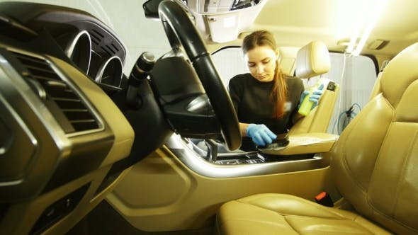 Thumbnail for Young Woman in Blue Gloves Is Cleaning Interior of the Car for Luxury SUV