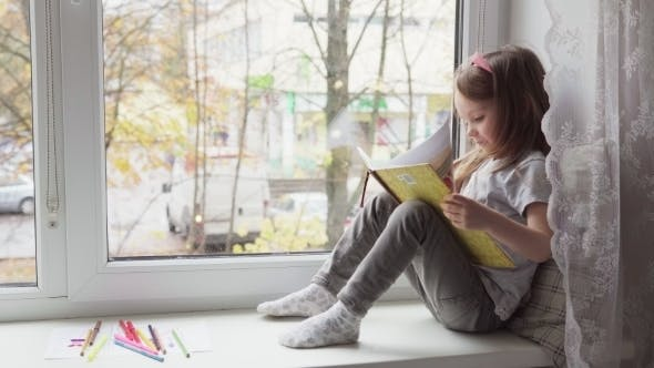 Thumbnail for Little Girl Reading a Book