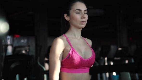 Thumbnail for Young Woman Walks on a Treadmill at the Gym. Cardio Exercises in the Gym