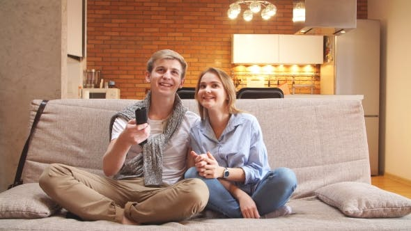 Thumbnail for Young Couple Watching TV on the Sofa in the Living Room