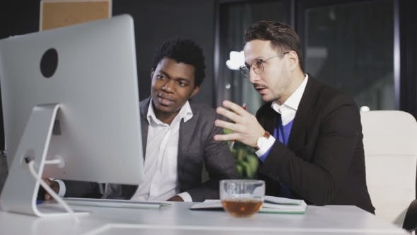 Thumbnail for Two Men in the Office Discussing the Project in Front of the Computer