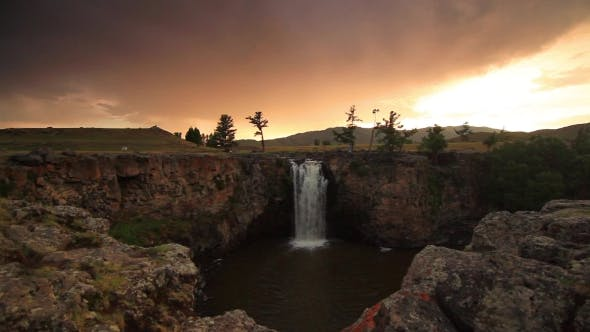 Thumbnail for Sunset Over Waterfall Ulaan Tsutgalan, Mongolia.