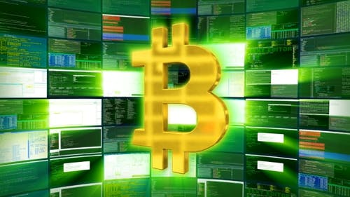 Gold Bitcoin Sign Against a Green Monitor Render