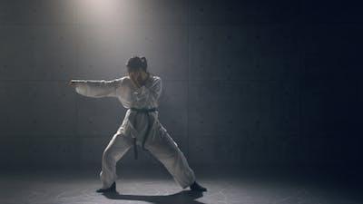 Young Woman in Kimono Practicing Karate