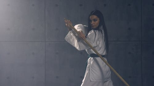 Young Woman in Kimono Practicing Martial Arts