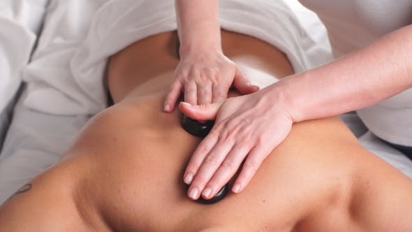 Thumbnail for Man Relaxing in Spa Salon with Hot Stones on Body. Beauty Treatment Therapy.