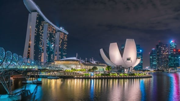 Thumbnail for Helix Bridge and Marina Bay Sands Hotel at Night in Singapore. August 2017