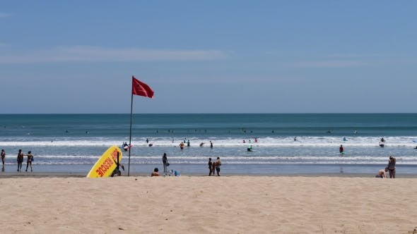 Thumbnail for Kuta Beach, Bali, Indonesia. Surf Rescue Point. Yellow Rescue Surfboard and Red Flag