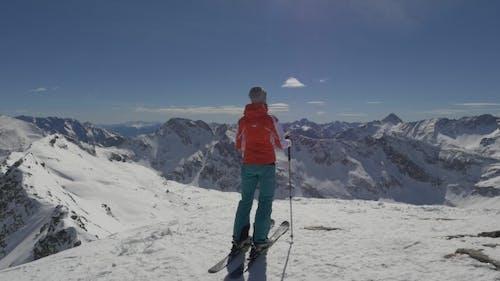 Skier Preparing To Ski Descent