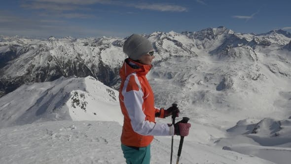 Thumbnail for Young Woman Skier at a Ski Resort in the Alps
