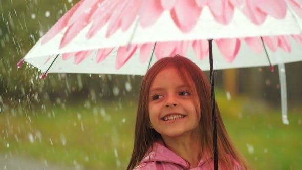 Thumbnail for Little Girl Having a Fun Under Rain