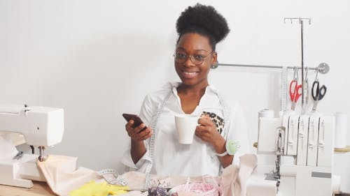 Happy Fashion Designer in Small Business Startup Company.