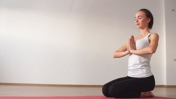 Thumbnail for Woman Practicing Yoga in a Studio Indoors.