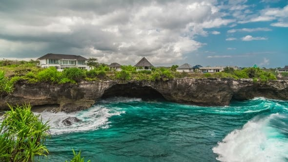 Thumbnail for Large Waves Break on the Rocks of the Island of Nusa Lembongan in Cloudy Weather, Indonesia