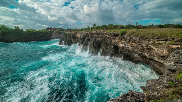 Thumbnail for Huge Waves Break About the Rocks on the Island Nusa Ceningan, Indonesia