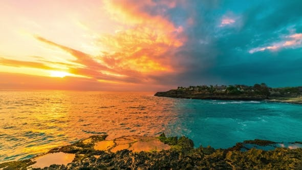 Cover Image for Sunset Sea Waves Break on the Rocks in Island Nusa Lembongan, Bali, Indonesia