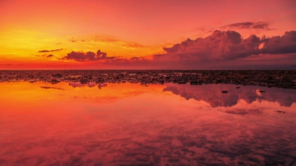 Cover Image for Beautiful Sunset and Clouds Reflection in Sea at the Island Nusa Lembongan, Indonesia