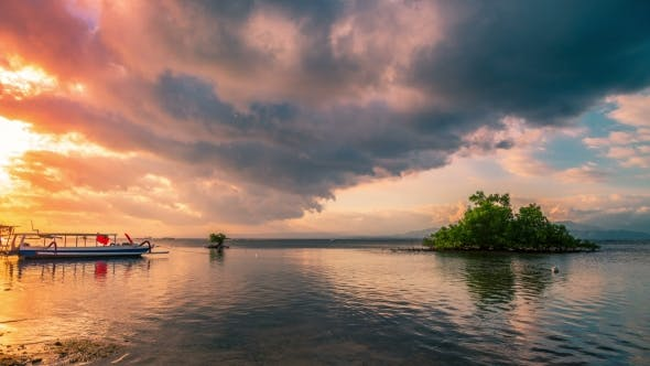 Cover Image for Mangrove Tree in Low Tide and Sunset with Indonesian Boats, Nusa Lembongan, Bali, Indonesia