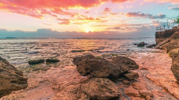 Cover Image for Sunset on the Stony Beach of the Island Nusa Ceningan, Indonesia