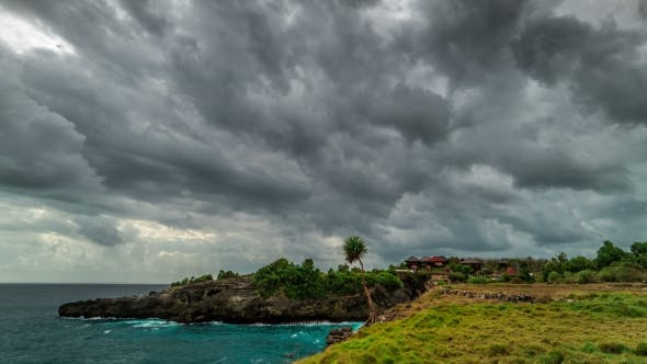 Cover Image for Storm Clouds Over the Nusa Ceningan Island in Cloudy Weather, Bali, Indonesia