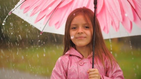 Thumbnail for Little Girl with Umbrella Under Rain