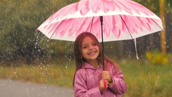 Thumbnail for Little Girl With Umbrella Dancing Under Rain
