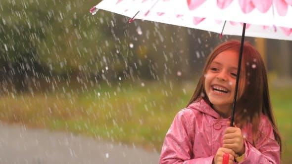 Thumbnail for Little Girl Under Rain Having a Fun