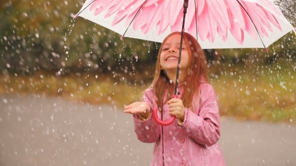 Thumbnail for Cheerful Girl with Umbrella Under Rain