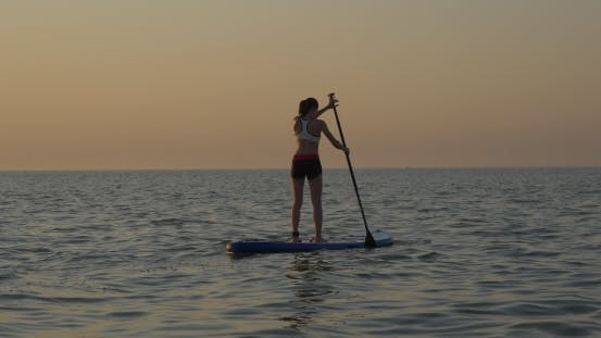 Thumbnail for Athletic Girl Rowing on Standup Paddle Board