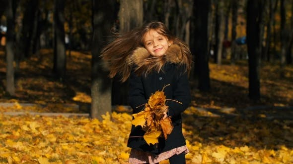 Thumbnail for Happy Little Girl Throws Leaves Up