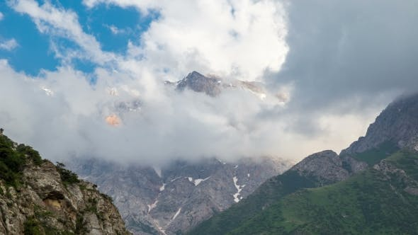 Cover Image for Clouds Above the Mountains in Sairamsu, Kazakhstan