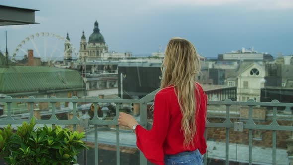 Thumbnail for Woman walking on a roof terrace