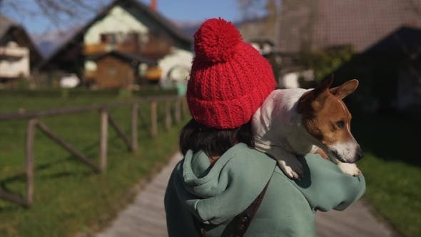 Thumbnail for Young Woman Walking and Holding Her Dog
